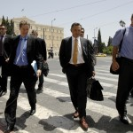 ECB's Masuch, EC's Deroose and IMF's Thomsen cross a street in front of the parliament in Athens