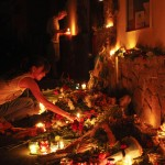 People light candles at the Malaysian embassy to commemorate the victims of Malaysia Airlines MH17, which crashed in eastern Ukraine, in Kiev
